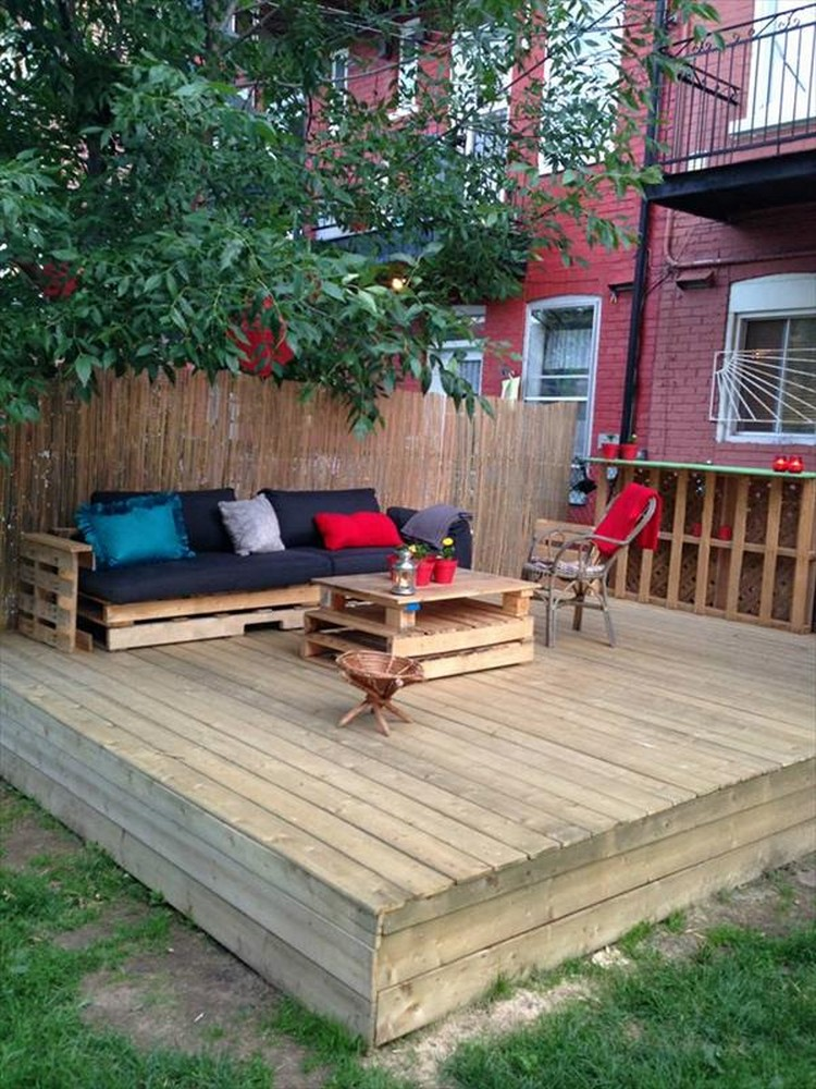 Diy pallet patio decks with furniture pallet wood projects for Patio construction ideas
