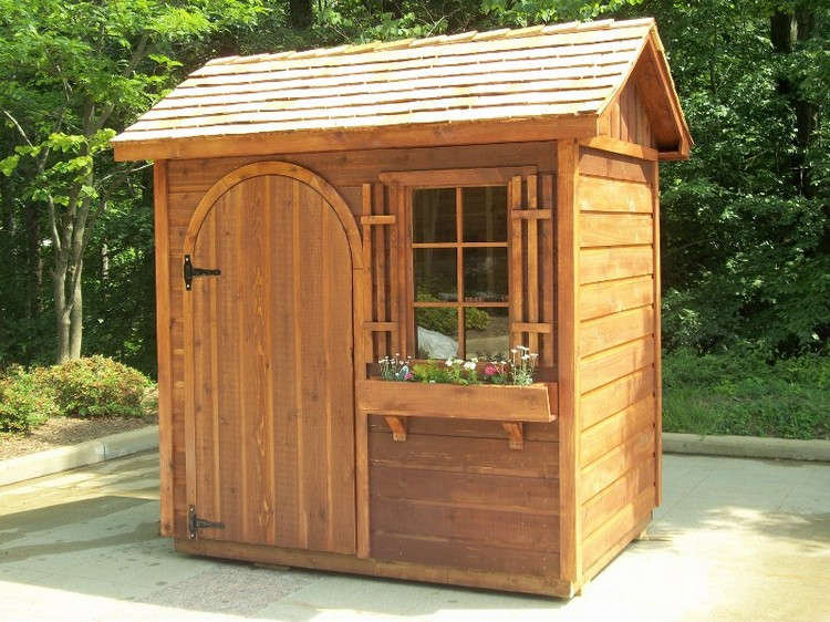 Diy wooden pallet shed projects pallet wood projects for Small backyard cabin