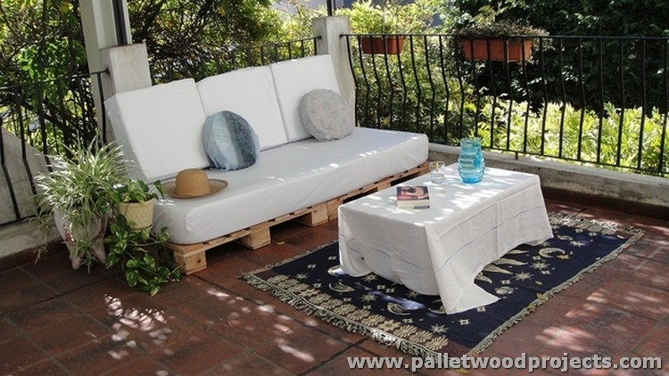 Outdoor Pallet Sofa with White Cushions