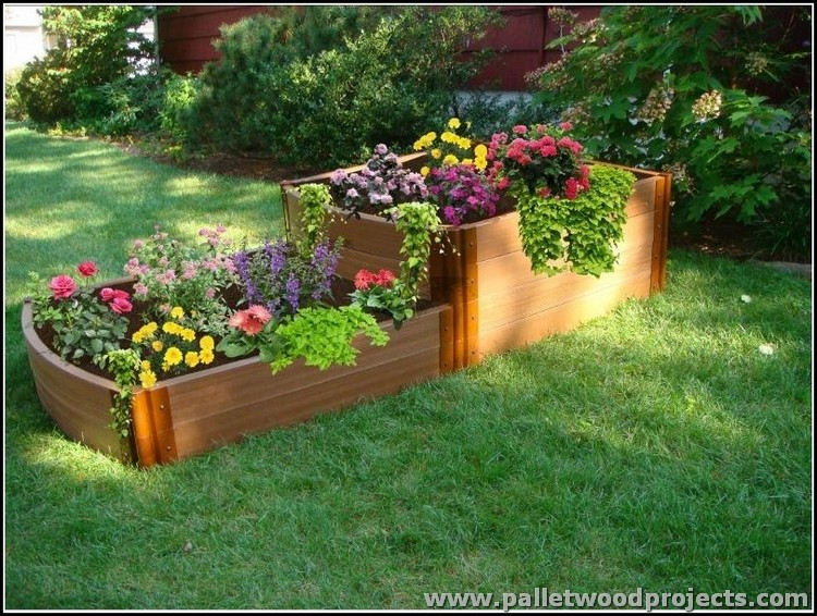the two pallet raised garden beds are placed in such a way that they