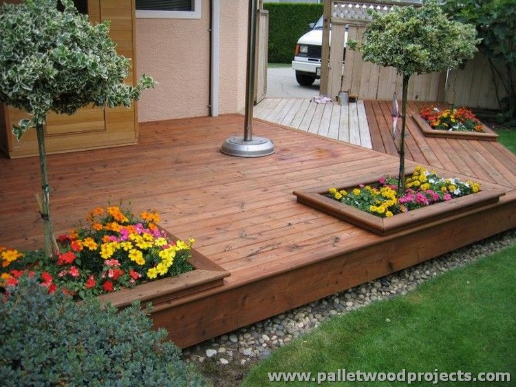 Reused wooden pallet projects pallet wood projects for Garden decking projects
