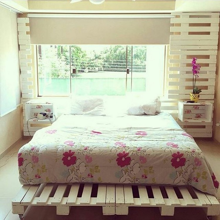 Pallet Bed with Side Table and Wall Decor