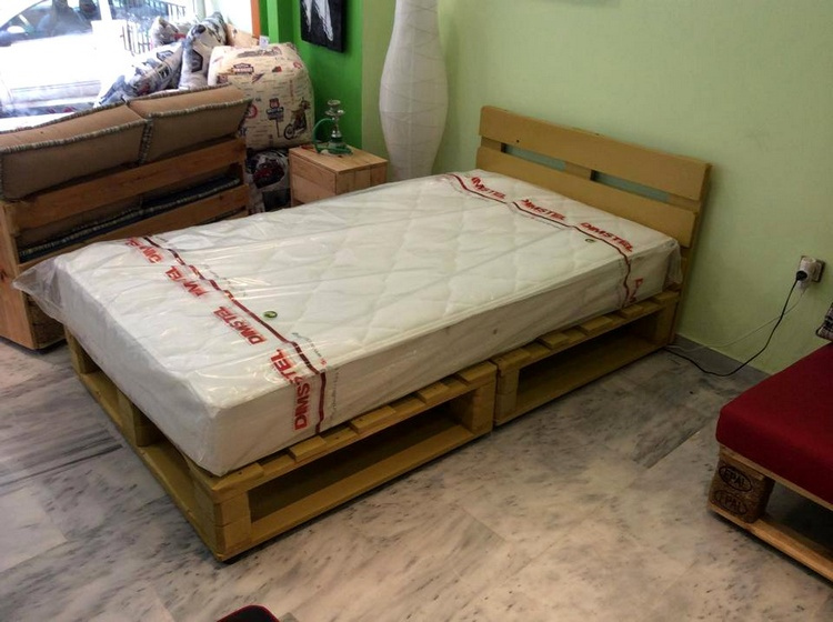 you can build this fine looking bed frame from recycled pallet woods we have also made a table to put aside it this bed frame is looking nice without a - Wooden Crate Bed Frame